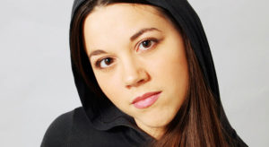 actor's headshot of a young aspiring actress with hooded shirt