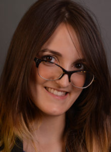 headshot of an actress in dc with glasses