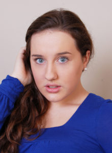 actor headshot of a young girl looking surpriseed