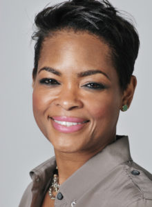 headshot of an executive woman in a casual shirt smiling