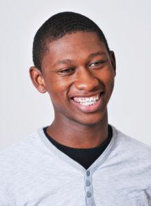 actor head shot of a black teen actor smiling