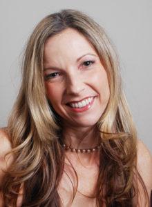professional headshot of a female freelance author for writer's bio