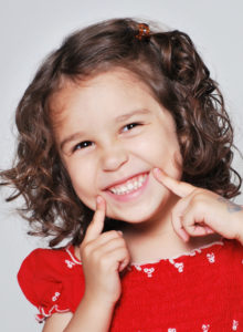 headshot of a child actress with an amusing expression on her face