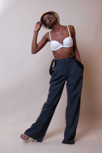 picture of a black model wearing a stylish white bra and a hat
