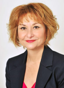 business headshot of a female executive in washington dc wearing a dark blue suit